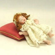 Sleeping girl with ringlets
