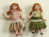 Doll in pleated dress